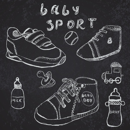 baby shoes: Baby shoes set sketch handdrawn on blackboard.