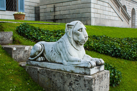 lieing: Bellagio city on Lake Como, Italy. Lombardy region. Italian famous landmark, Villa Melzi Park. sculpture of lieing lion.