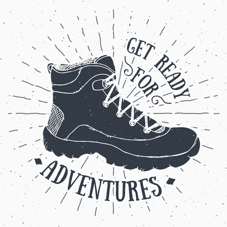 Vintage label, grunge textured Hand drawn retro badge or T-shirt typography design with hiking shoe, trekking boot illustration 向量圖像