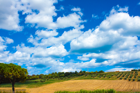 Italy landscape view with clouds on blue sky, Italian fields