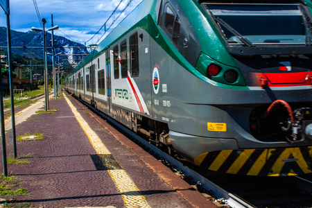 STRESA, ITALY - JULY 14, 2016. Stresa railway station and arriving train Trenord Italia Publikacyjne
