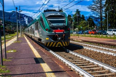 STRESA, ITALY - JULY 14, 2016. Stresa railway station and arriving train Trenord Italia Editorial