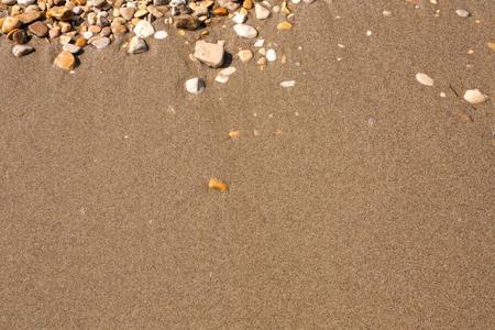 Rocks and Stone beach pattern closeup, Summer seacoast background.