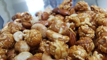 Save Download Preview Caramel popcorn close up. Horizontal photo. Sweet food