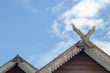 Gable roof house in Thai style and White clouds and beautiful clear sky.
