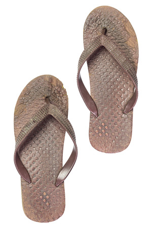 Old brown sandals on isolate white background. Very dirty slippers. Stock Photo