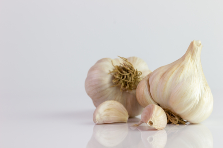 Two garlic on white background. Ingredients for cooking.