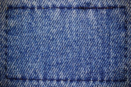 Frame or border of jeans fabric stitch. Concept of vintage clothes or fashion.