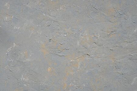 Close up texture of grey color painting on cement wall.