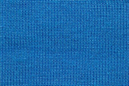 Texture of blue jacket fabric. Concept of clothes or fashion.