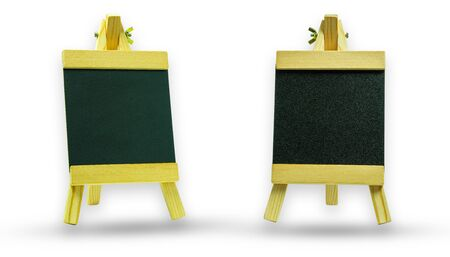 Blank chalkboard in wooden frame and easel. Isolate and on white background.