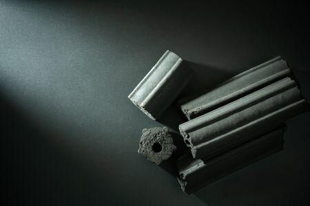 Carbon activated. Bamboo charcoal compressed in to stick on darkness background. Has the ability to absorb toxins in the human body. Concept of health care. Top view and copy space. Imagens