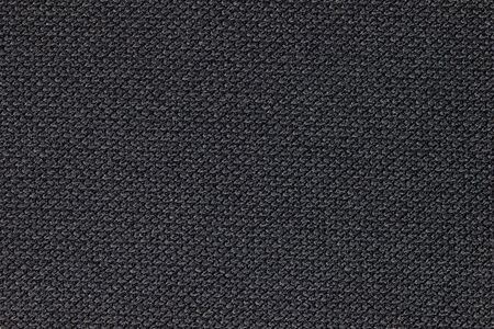 Texture of black fabric. Concept of fashion article background.