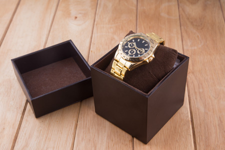 luxury watch: box with luxury watch on wooden background Stock Photo