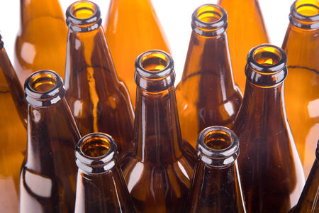 6 pack beer: Brown beer bottles stacked on white background