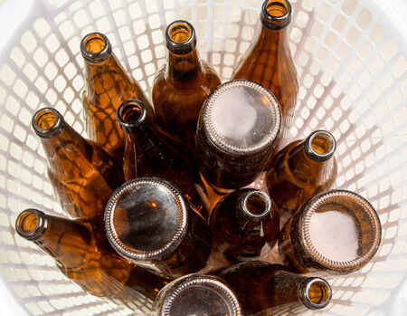 6 pack beer: Brown beer bottles stacked isolated on white background