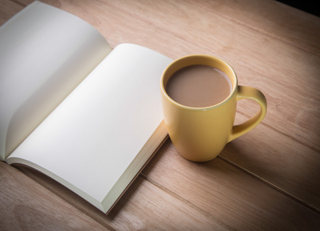 coffee cup with notebooks  photo