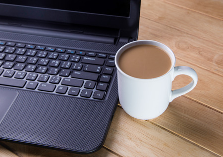 Coffee cup with the computer  photo