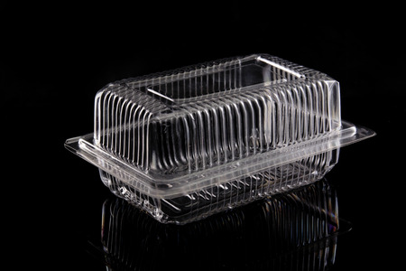 Transparent plastic box on black background