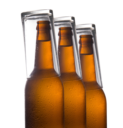 dewed: Beer bottles isolated on white background,