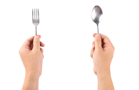 fork spoon: Hand hold spoon on white.