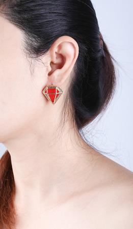 pierced ears: luxury earring in girl ear