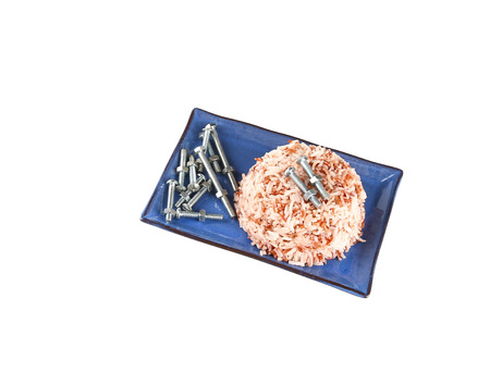 white rice: Brown rice with screw in plate on a white background.Concept eat screw instead of food.