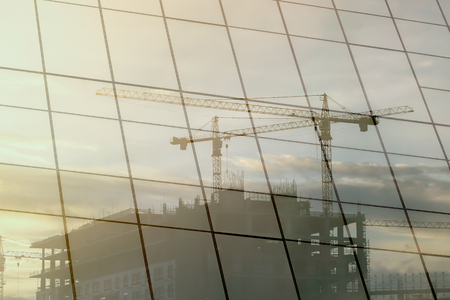 civil construction: Reflective glass building of worker construction.