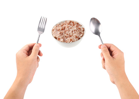 plastic spoon: Hand hold a spoon with rice bowl isolated on a white. Stock Photo