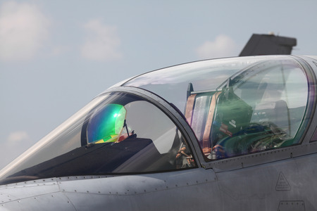 afterburner: Close-up of an air force pilot in the cockpit of an airplane. Head-on view.