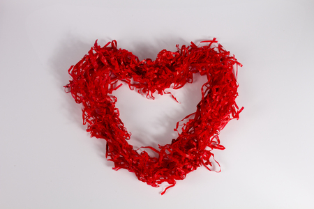 torn edge: Red paper hearts on white. Stock Photo