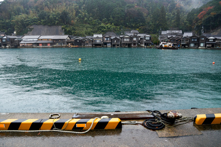 Ine Boathouse is traditional Fisherman Village on a rainy day of Kyoto, JAPAN.
