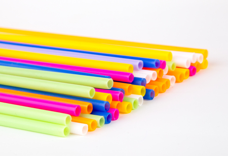 Colorful plastic tubes isolated on a white background. Close up. Stock Photo