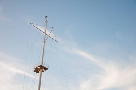 gaff: Mast ship on the background of blue sky