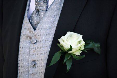 groom suit with white rose