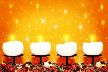 Christmas candles against warm shiny background  photo