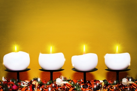 Christmas candles against golden background  Stock Photo