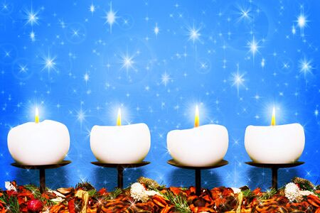 Christmas candles against blue stars background Stock Photo - 16111050