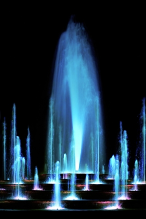 Blue water fountain at night