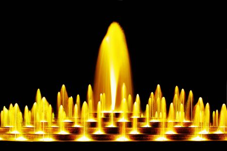 Yellow water fountain at night