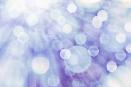 Blue spotted background with rays of light Stock Photo