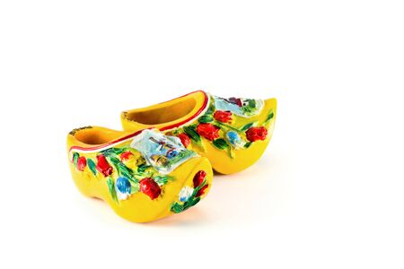 Yellow Dutch shoes isolated on white photo