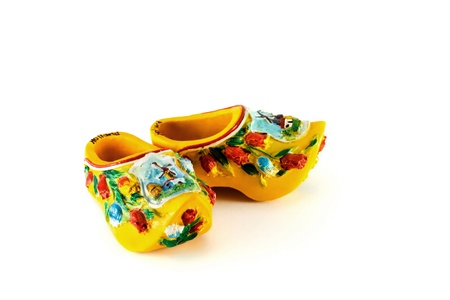 wooden shoes: Yellow Dutch shoes isolated on white
