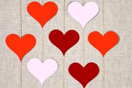 Hearts garlands on linen background