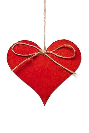 Red heart hanging in thread