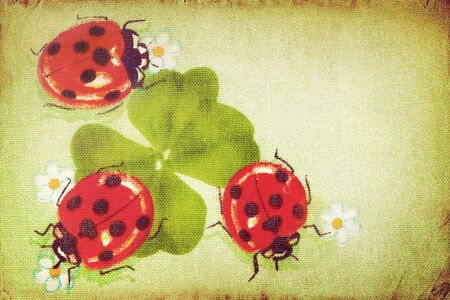 Vintage ladybugs on the clover leaf  photo
