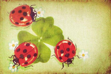 Vintage ladybugs on the clover leaf Stock Photo - 18687032