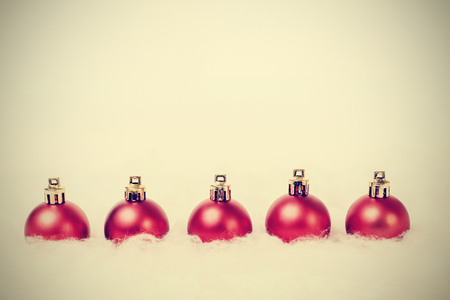 Christmas balls arranged in a row  photo