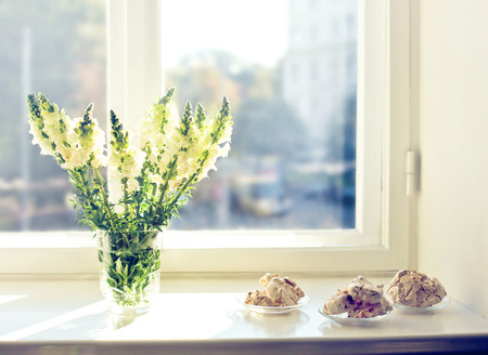 glass vase: Flowers and cakes at early morning