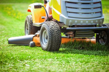 Closeup of mower cutting the grass